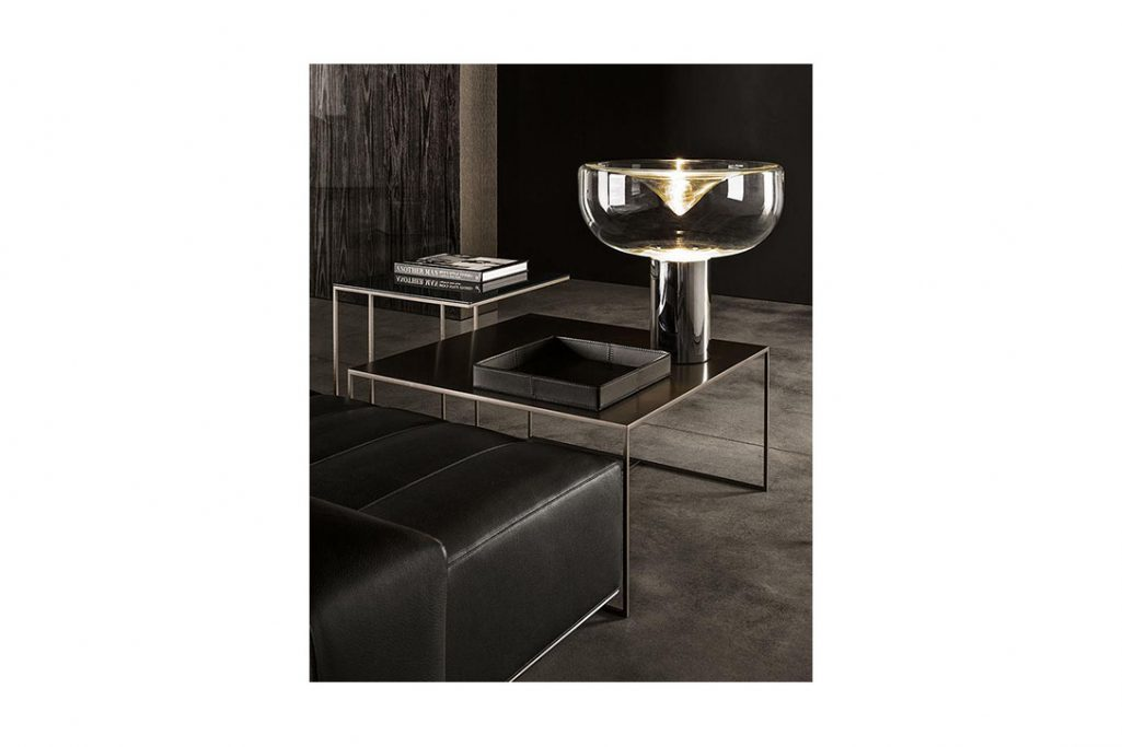 modern living room featuring two minotti duchamp bronze tables