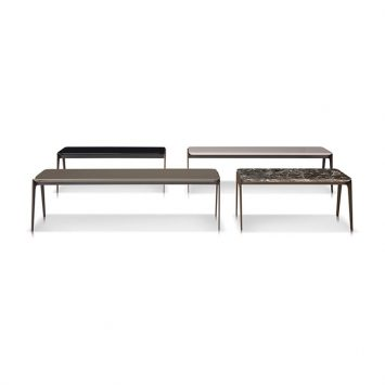 minotti kirk coffee tables with metal base on a white background