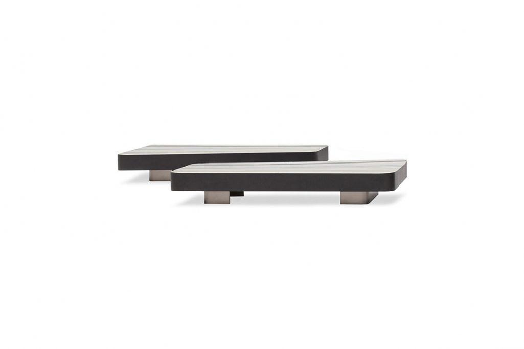 two trapezoidal minotti milton coffee tables on a white background
