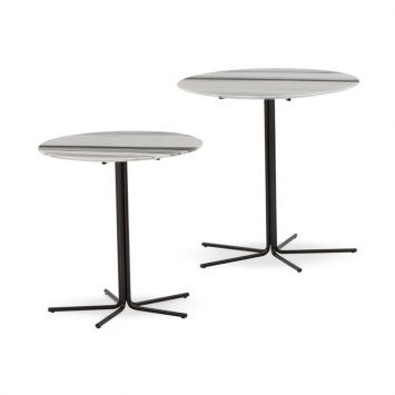 two minotti rays side tables on a white background