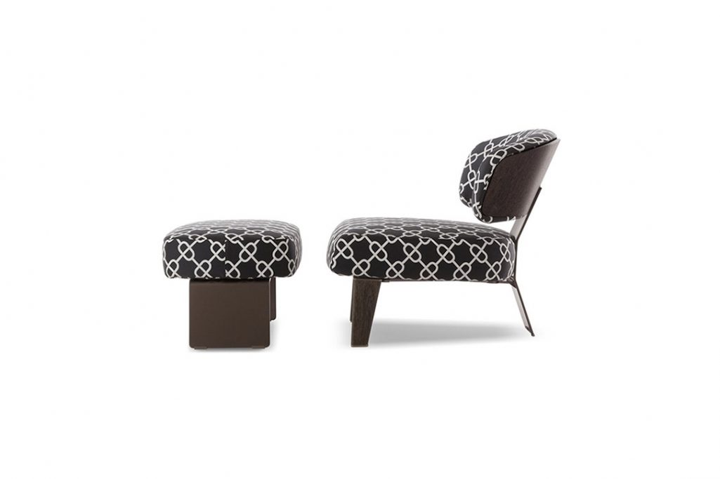 minotti reeves armchair and ottoman on a white background