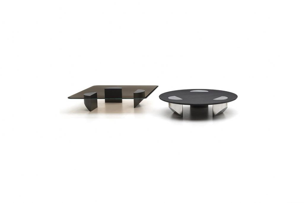 two minotti wedge coffee tables on a white background