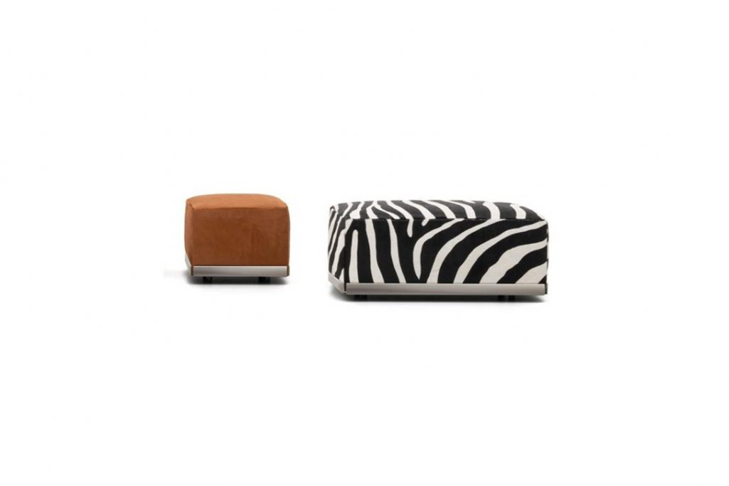 two minotti west poufs on a white background