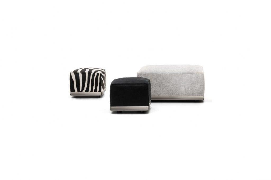 three minotti west poufs on a white background