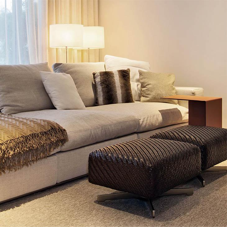 modern living room featuring flexform filicudi ottomans
