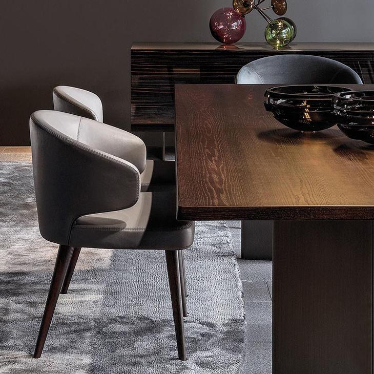 modern dining room featuring minotti aston dining arm chairs