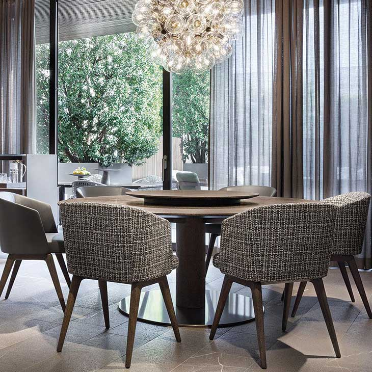 modern dining room featuring a minotti bellagio dining table