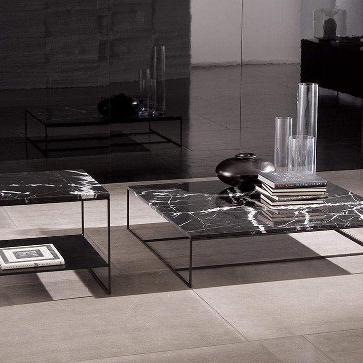 modern living room featuring two minotti calder tables