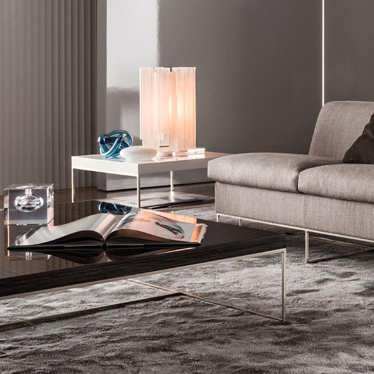 modern living room featuring a minotti calder coffee table