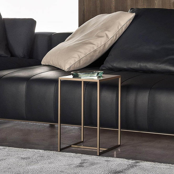 modern living room featuring a minotti duchamp bronze table