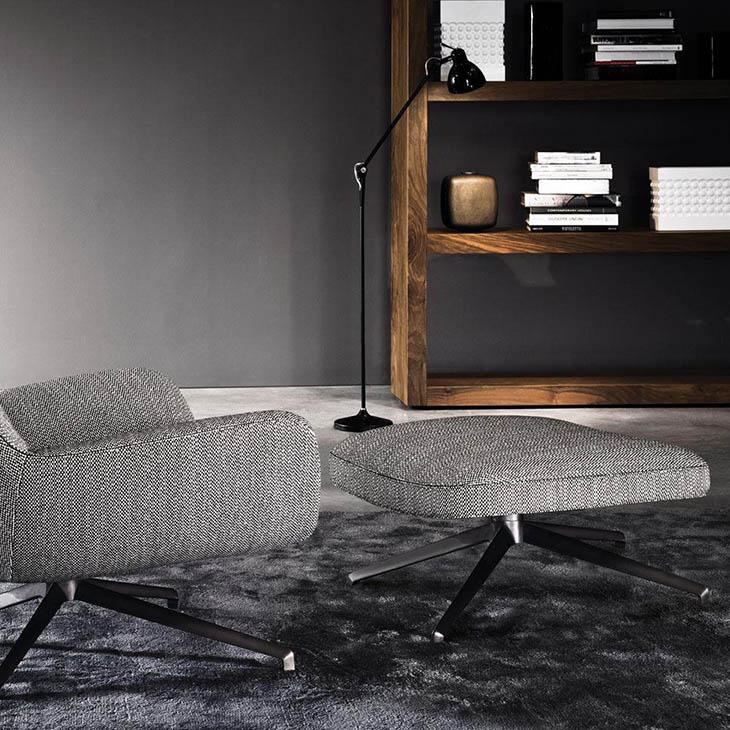 modern living room featuring minotti jensen armchair and ottoman