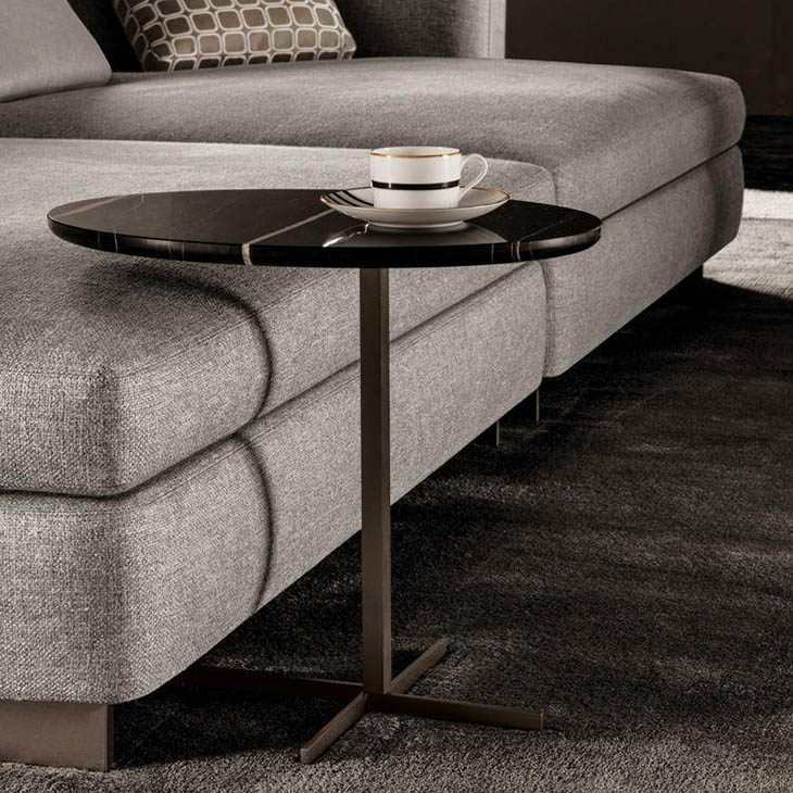 modern living room featuring a minotti joy jut out side table