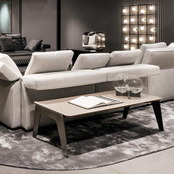 modern living room featuring a minotti kirk coffee table