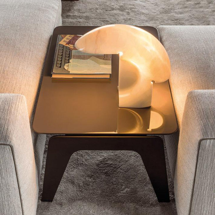 modern living room featuring a minotti kirk side table