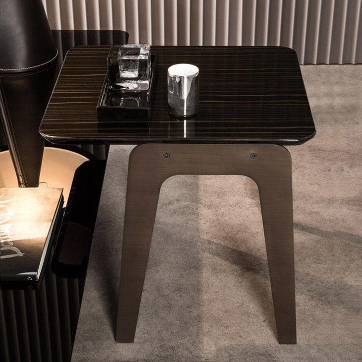 modern living room featuring a minotti kirk jut out top side table