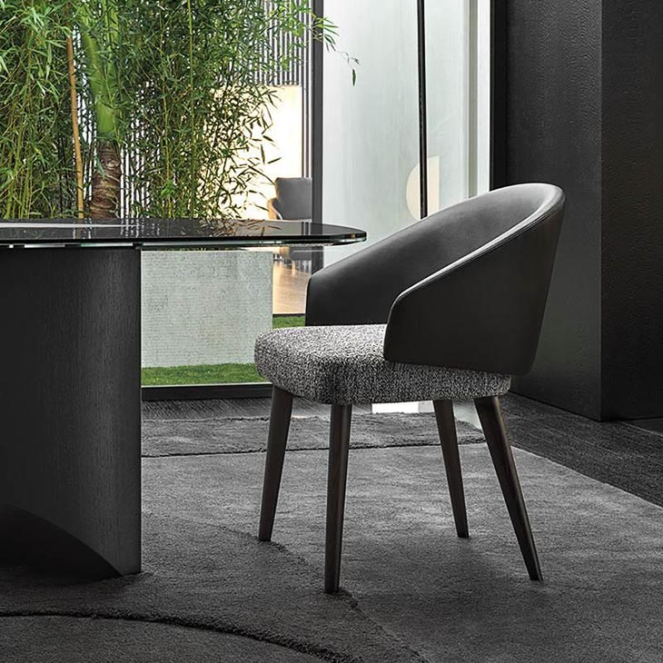 modern dining room featuring minotti lawson dining chair