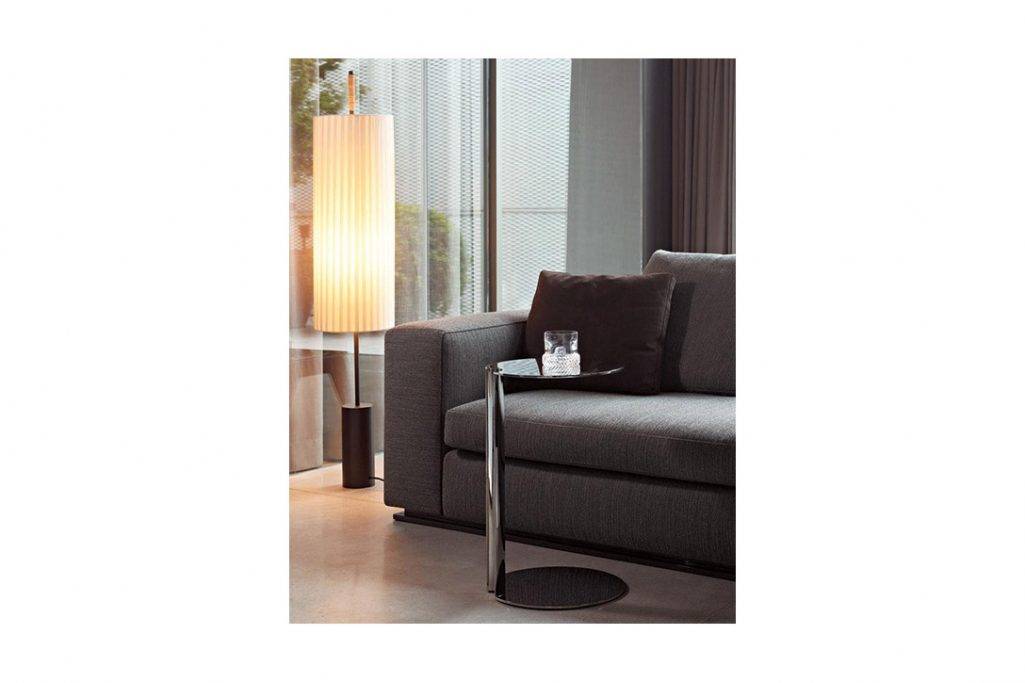 modern living room featuring minotti nay side table