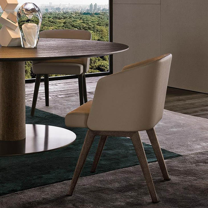 modern dining room featuring minotti reeves dining chairs