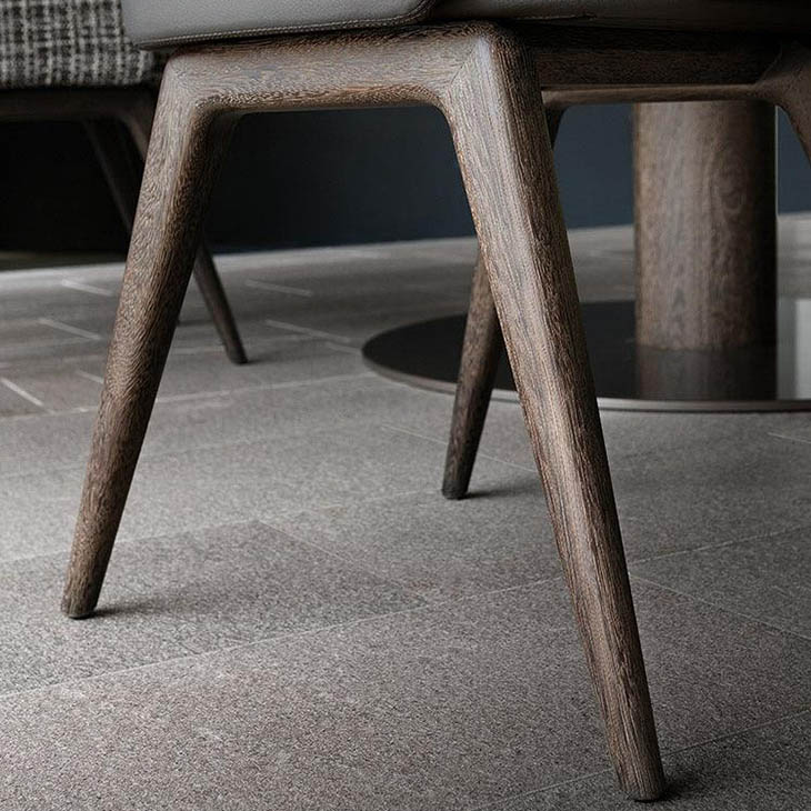 close up of solid sucupira legs on a minotti reeves dining chairs