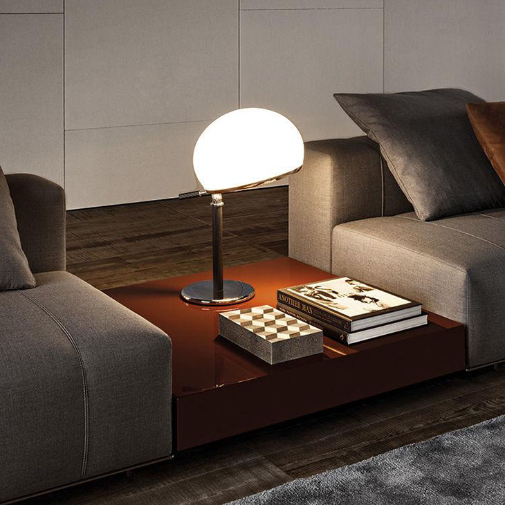 modern living room featuring a minotti ritter coffee table