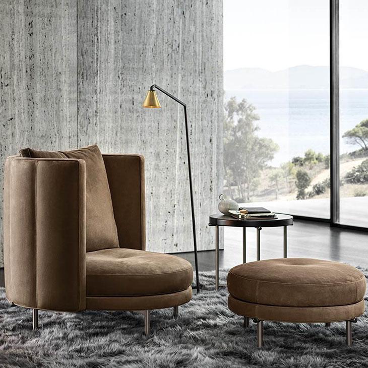 modern living room featuring a minotti torii armchair and ottoman