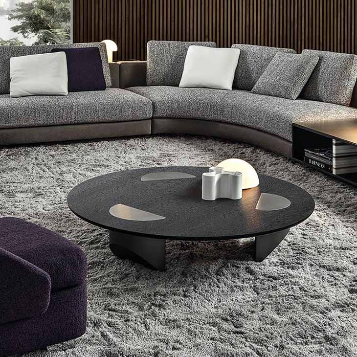 modern living room featuring a minotti wedge coffee table