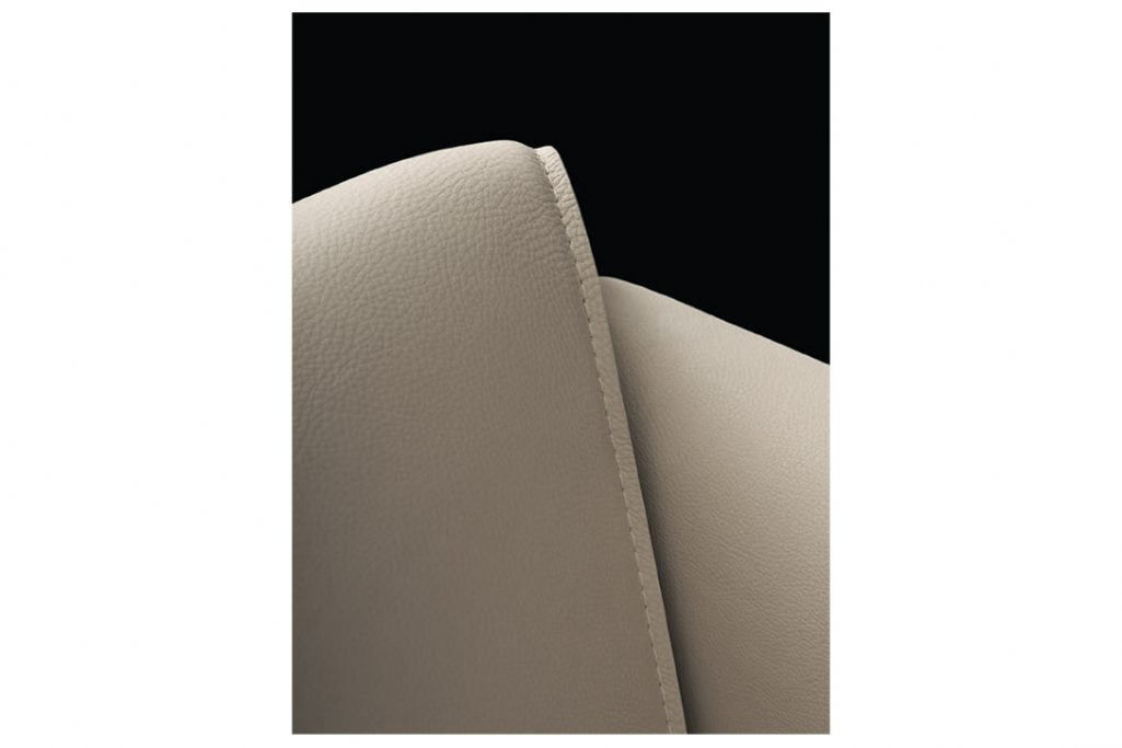 detail of leather and stitching on poliform le club armchair