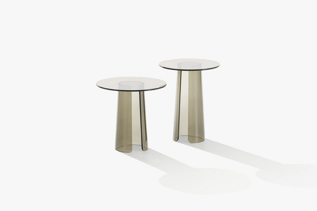 two poliform orbit side tables on a white background