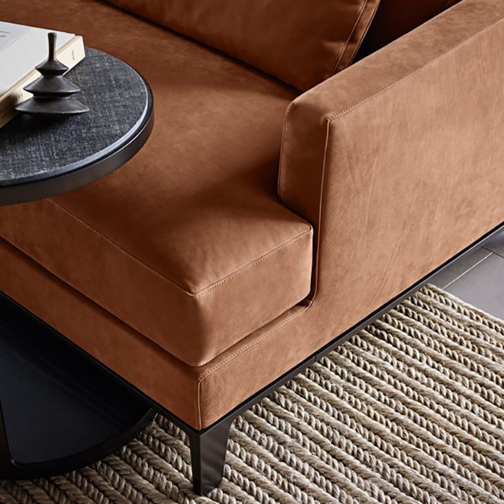 detail of the leg and arm on a poliform bellport sofa