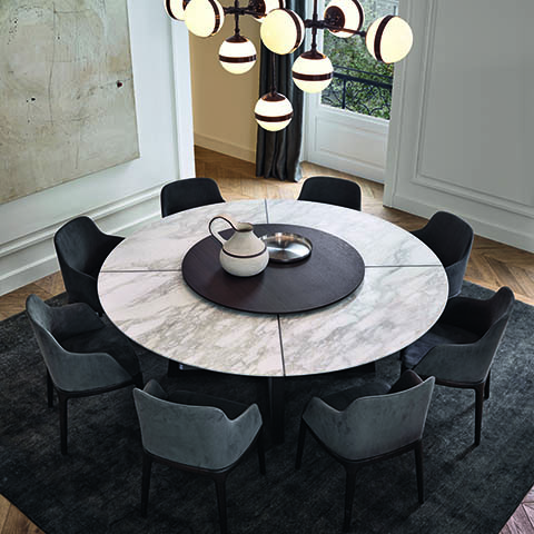 modern dining room featuring a poliform concorde dining table