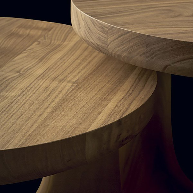 detail of two poliform nara side tables in hickory walnut gold