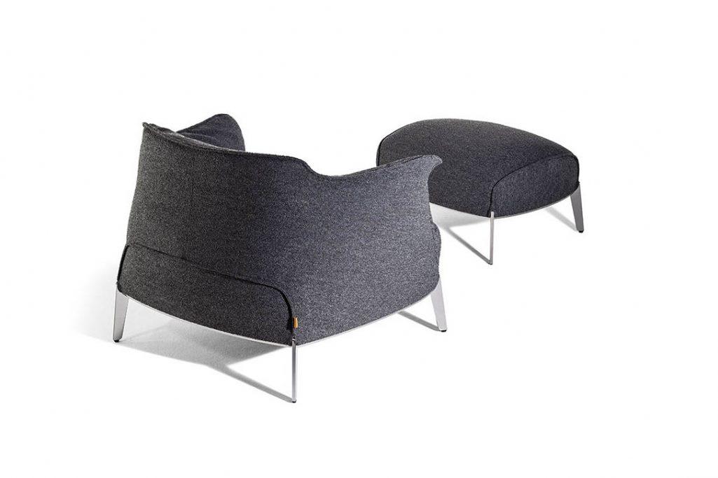 back view of a poltrona frau archibald gran comfort armchair and ottoman