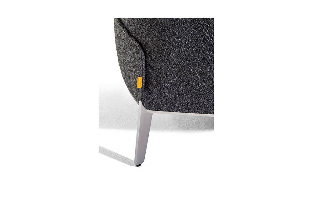 leg detail on a poltrona frau archibald gran comfort armchair in fabric
