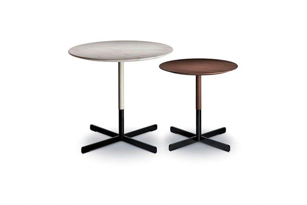 two poltrona frau bob side tables on a white background