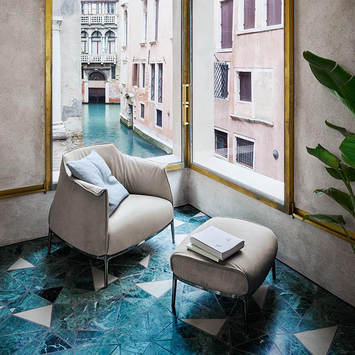 poltrona frau archibald gran comfort armchair and ottoman in situ