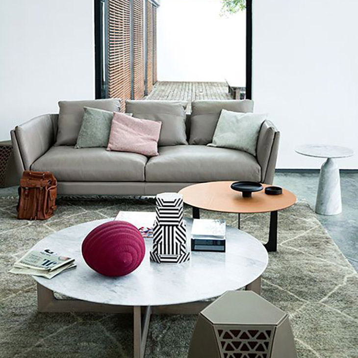 poltrona frau ilary coffee tables and monolithic side table in situ