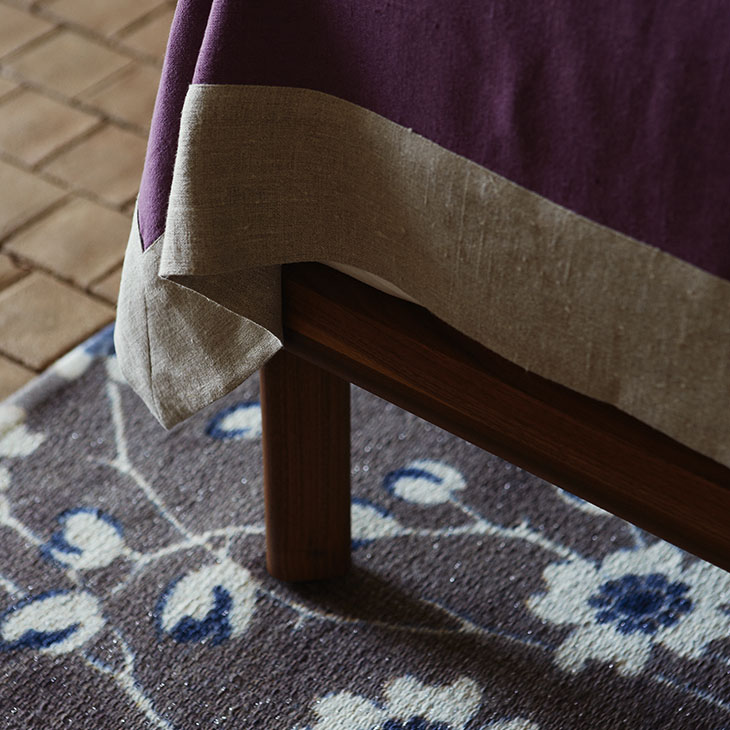 leg detail on a de la espada dubois bed low headboard with bedside tables