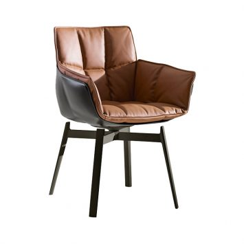 b&b italia husk chair with metal base on a white background